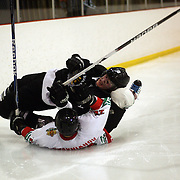 Teodor Kraynyanov, Bulgaria, and Connor Harrison, New Zealand, fall while challenging during the New Zealand V Bulgaria 2012 IIHF Ice Hockey World Championships Division 3 held at Dunedin Ice Stadium. Dunedin, Otago, New Zealand. 17th January 2012. Photo Tim Clayton