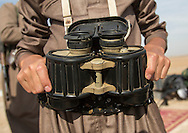 Iraq, Kurdistan, Kirkuk, kurdish peshmerga with binoculars on the frontline