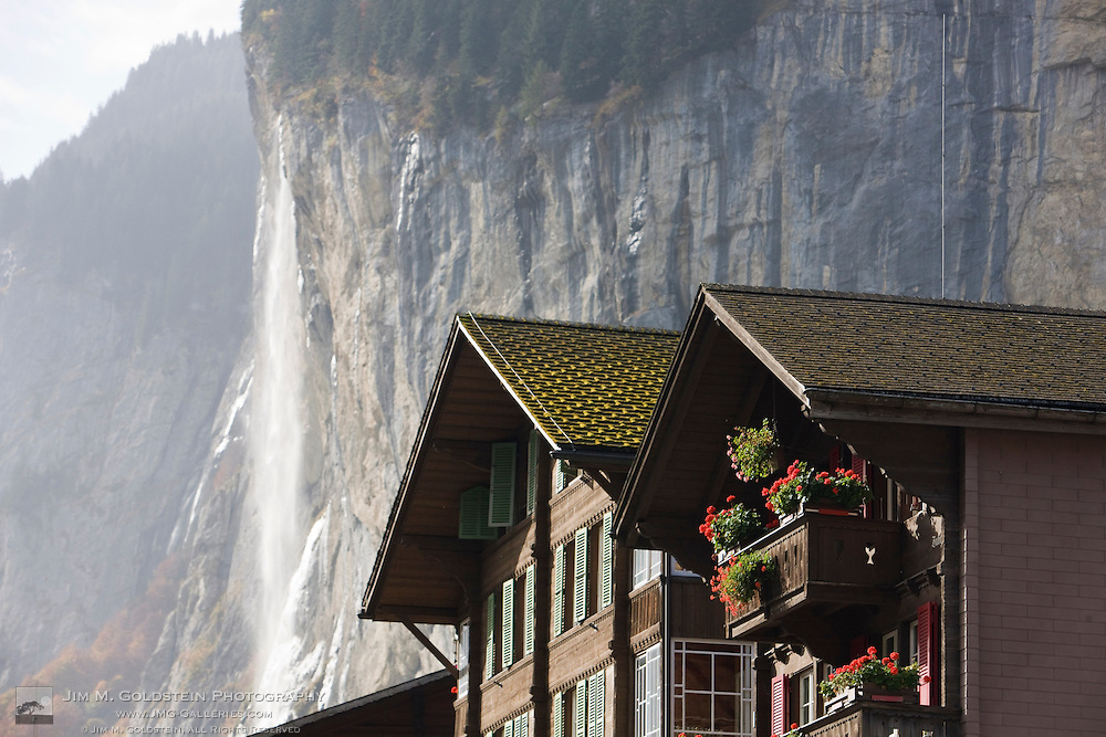 Geraniums decorate the windows of Lauterbrunnen homes in front of Staubbach Falls - Switzerland