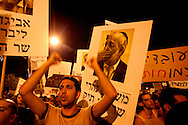 Israeli protestors holding signboards with images of Israeli ministers, emphasizing the government's apathy to the worsening social conditions of the people, during the massive demonstration over the rising cost of living in the country. Tel-Aviv, 6 Aug 2011.<br /> <br /> At least a courter of million Israelis marched in a protest against the rising cost of living in Israel, in central Tel Aviv,  Saturday, Aug. 6, 2011. The Israeli citizens are furious over the worsening social conditions in the country due to the increasing pricing of housing, taxes and basic products and also protesting over the lack of social welfare. Israelis poured en masse into the streets of major cities on Saturday night in a massive demonstration. Thousands of mostly middle class Israelis marched through the streets of the city waving flags, beating drums and shouting: &quot;The people demand social justice&quot;.