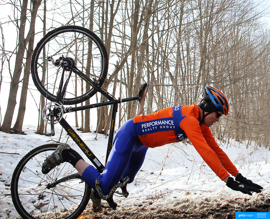 The thrills and spills of the Newtown CX, Cyclocross Event as Jim Themig, Niantic, Connecticut, goes over the handle bars as he navigates a slippery slope of mud and melting snow while competing in the Masters 55+ category. The event was organized by The Connecticut Cycling Advancement Program and Team 26, a group of cyclists affected by the tragedy at Sandy Hook School. Fairfield Hills, Newtown, Connecticut, USA. 21st December 2013. Photo Tim Clayton