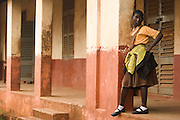A girl stands outside the Zogbeli Junior Secondary School in Tamale, Ghana on Thursday June 7, 2007.