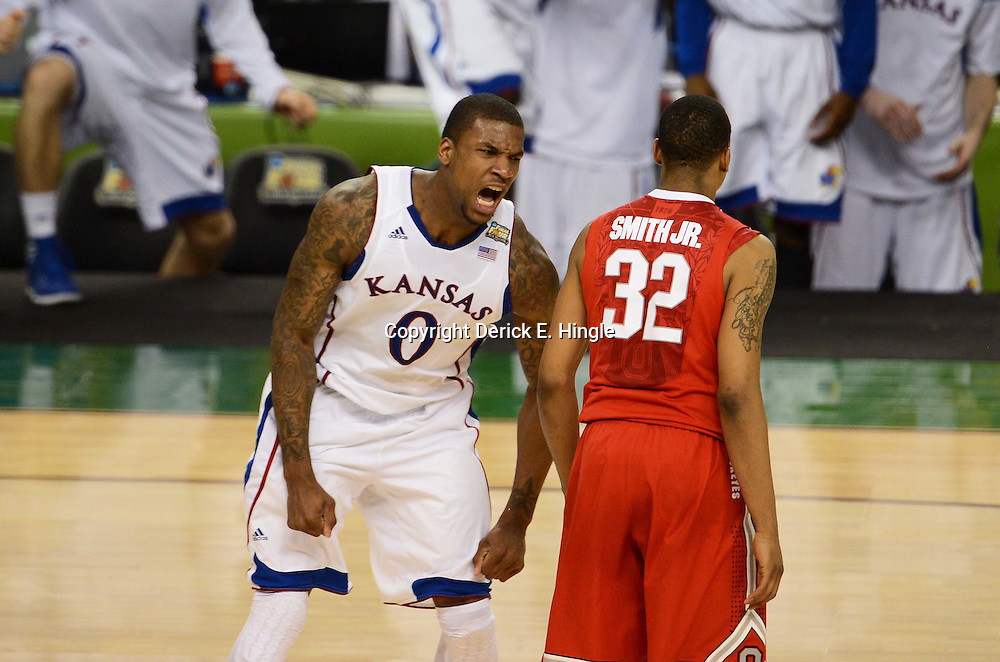 Mar 31, 2012; New Orleans, LA, USA; Kansas Jayhawks forward Thomas Robinson (0) reacts after a dunk as Ohio State Buckeyes guard Lenzelle Smith, Jr. (32) looks on during the second half in the semifinals of the 2012 NCAA men's basketball Final Four at the Mercedes-Benz Superdome. Mandatory Credit: Derick E. Hingle-US PRESSWIRE