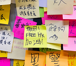 Pro democracy and anti extradition law protests, slogans and posters on Lennon Walls in Hong Kong. Pic Lennon Wall protest notes at City University of Hong Kong.