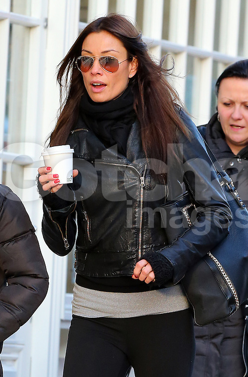 Melanie Sykes without her wedding ring, wearing a black leather bikers jacket, grey top, black leggings and grey leg warmers out and about in London, UK. 18/12/2013<br />