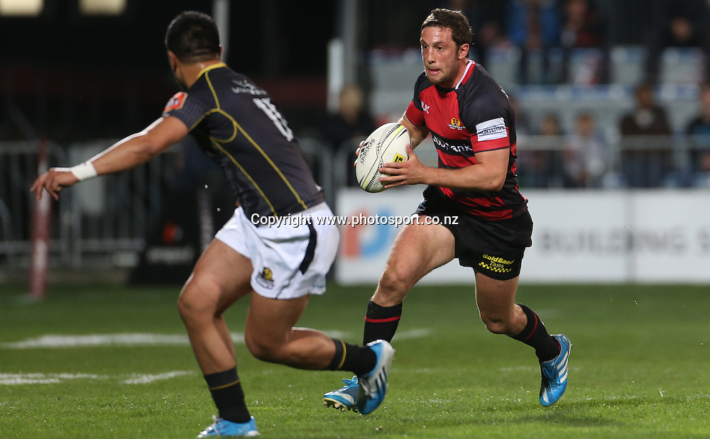 Canterbury first five eighth Tom Taylor runs at Wellington left wing Belgium Tuatagaloa<br /> ITM Cup match between Canterbury and Wellington, held at AMI Stadium, Christchurch, New Zealand, 12 September 2014. Credit: www.photosport.co.nz