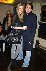 EUGENIE WARRE and RICHARD DENNEN at the launch of a new bar Bardo, 101-105 Walton Street, London SW3 on 29th November 2005.<br />