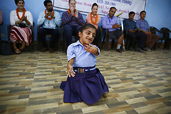 September 5, 2017 - Kathmandu, Nepal - A girl with disabilities performs a dance for Jessica Cox who is the world's first licensed armless pilot reacts during a program for people with disabilities in Kathmandu, Nepal on Tuesday, September 05, 2017. This is her first visit to the Asian region invited by Handicap International. She is also here to share stories to inspire people like her to become someone of value. (Credit Image: © Skanda Gautam via ZUMA Wire)