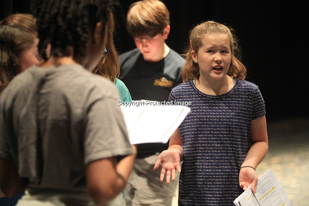 "Jesse Brooks, 11, of Tupelo, practices her lines as she portrays, Autumn, during rehearsal for the play, ""Invisible Eye for the Nerd Guy"", at Pied Piper Players Theater Camp Wednesday morning at Tupelo High School."