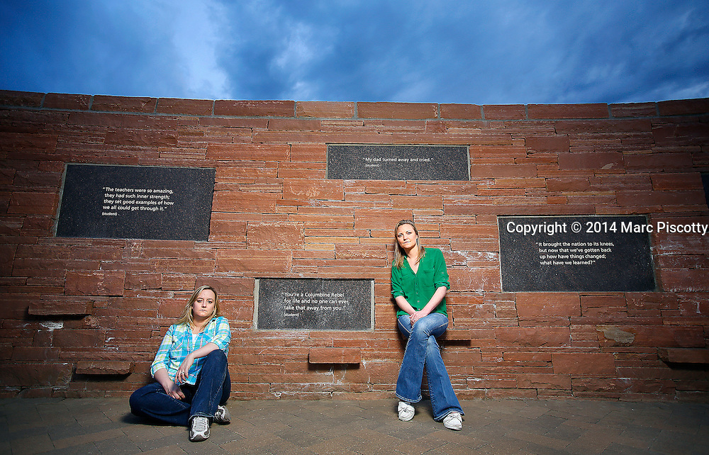 SHOT 4/18/14 7:15:26 PM - Former Columbine High School students Jennifer Hammer (left), 33, of Commerce City, Co. and Heather Egeland, 32, of Littleton, Co. pose for a portrait at the Columbine Memorial recently. The two are co-founders of The Rebels Project, a support group that has helped survivors of other mass shootings around the country, from Virginia Tech to Chardon, Ohio to Newtown, Conn. On the day of the Columbine shootings in 1999 the two were huddled in the choir office with about 60 other students hiding from the shooters. (Photo by Marc Piscotty / © 2014)