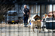 Naoto Matsumura takes care of pets and other animals left behind in the government-imposed no-go zone about 10 km from the Fukushima Daiichi Nuclear Power Plant in Tomioka, Fukushima  Prefecture, Japan on 01 Mar. 2012. . .Photographer: Robert GilhoolyNaoto Matsumura takes care of pets and other animals left behind in the government-imposed no-go zone about 10 km from the Fukushima Daiichi Nuclear Power Plant in Tomioka, Fukushima  Prefecture, Japan on 01 Mar. 2012. . .Photographer: Robert GilhoolyNaoto Matsumura feeds a dog that he numbers among the pets and other animals he looks after that were left behind in the government-imposed no-go zone about 10 km from the Fukushima Daiichi Nuclear Power Plant in Tomioka, Fukushima  Prefecture, Japan on 01 Mar. 2012. . .Photographer: Robert Gilhooly
