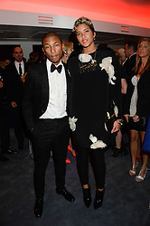 PHARRELL WILLIAMS and his fiancé HELEN LASICHANH at the GQ Men of The Year Awards 2013 in association with Hugo Boss held at the Royal Opera House, London on 3rd September 2013.