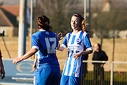 Ellie Lock (right) congratulates  scorer (no12) Megan Fox during the FA Women's Sussex Challenge Cup semi-final match between Brighton Ladies and Hassocks Ladies FC at Culver Road, Lancing, United Kingdom on 15 February 2015. Photo by Geoff Penn.