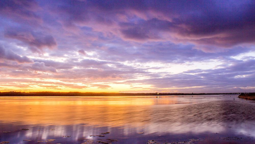 Algarve QDL cloudscape Sunset timelapse at Ria Formosa wetlands reserve, southern Portugal, famous nature destination.