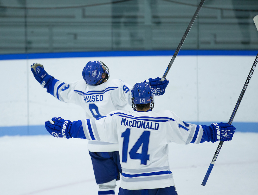 EJ Rauseo and Cam MacDonald, of Colby College, in a NCAA Division III hockey game against the Middlebury College on November 16, 2014 in Waterville, ME. (Dustin Satloff/Colby College Athletics)