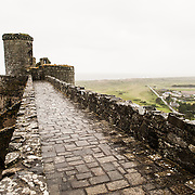 View from the ramparts looking towards the Irish Sea at Harlech Castle in Harlech, Gwynedd, on the northwest coast of Wales next to the Irish Sea. The castle was built by Edward I in the closing decades of the 13th century as one of several castles designed to consolidate his conquest of Wales.