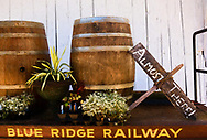 intimate scene of wine barrels, plants and Blue Ridge Railway cart at Pharsalia, VA