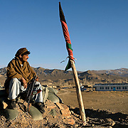 Auxiliary Police man a small outpost in Ahmadaba, Paktia Province, Afghanistan on the 5th of December, 2007. The auxiliaries are being recruited from local tribes such as the Ahmadzai, these same men were previously part of tribal militias known as Arbakee who provided security and represented law and order in remote regions with little or no official police presence.