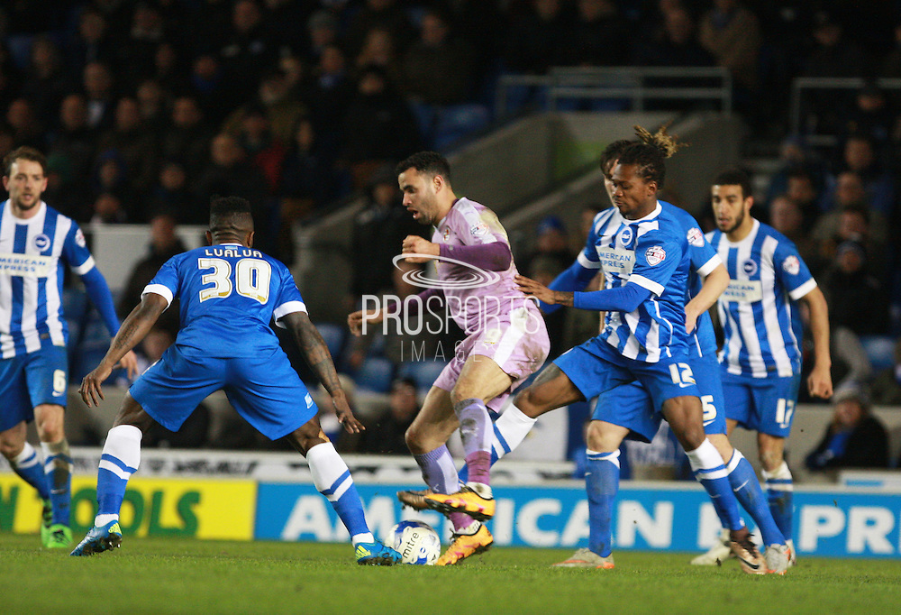 Reading midfielder Hal Robson-Kanu shields the ball from Brighton defender full back Gaetan Bong during the Sky Bet Championship match between Brighton and Hove Albion and Reading at the American Express Community Stadium, Brighton and Hove, England on 15 March 2016. Photo by Bennett Dean.