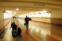 28 July 2005:  Amtrak SurfLiner train from Anaheim to Santa Barbara, CA.  Commuters walk down the tunnel to their trains at Union Station inside a downtown Los Angeles Landmark.