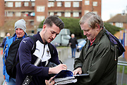 AFC Wimbledon goalkeeper Joe McDonnell (24) signing autpgraphs during the EFL Sky Bet League 1 match between AFC Wimbledon and Wigan Athletic at the Cherry Red Records Stadium, Kingston, England on 16 December 2017. Photo by Matthew Redman.