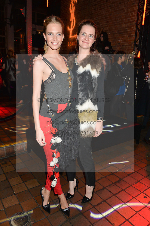 Left to right, sisters POPPY DELEVINGNE and CHLOE DELEVINGNE at the YSL Beauty: YSL Loves Your Lips party held at The Boiler House,The Old Truman Brewery, Brick Lane,London on 20th January 2015.