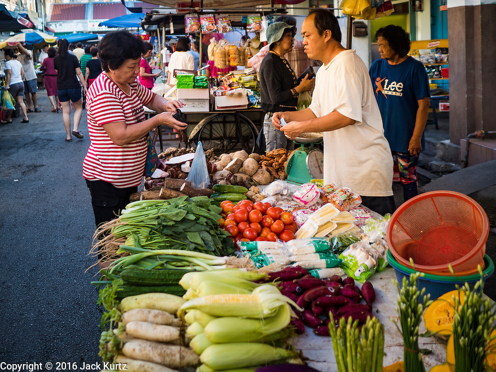 17 NOVEMBER 2016 - GEORGE TOWN, PENANG, MALAYSIA: A produce vendor in a market in George Town, Penang, Malaysia. George Town is a UNESCO World Heritage city and wrestles with maintaining its traditional lifestyle and mass tourism.       PHOTO BY JACK KURTZ