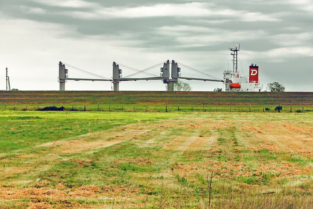 Ship docked on east bank of Mississippi River, behind farmed field in Venice, LA.  Copyright 2011 Reid McNally.