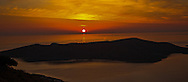 Just as the sun peaks from the horizon the Bay of Elounda turns a golden orange.