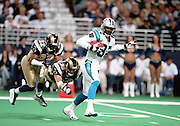 Wide Receiver Muhsin Muhammad (87) of the Carolina Panthers tries to run from Defensive Backs Dre' Bly (32) and Rich Coady (38) of the St. Louis Rams during a 48 to 14 win by the Rams on 11/11/2001..©Wesley Hitt/NFL Photos