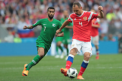 June 14, 2018 - Moscow, Russia - Midfielder Salman Alfaraj of Saudi Arabia National team and defender Sergey Ignashevich of Russia National team during the Group A match between Russia and Saudi Arabia at the 2018 soccer World Cup at Luzhniki stadium in Moscow, Russia, Tuesday, June 14, 2018. (Credit Image: © Anatolij Medved/NurPhoto via ZUMA Press)
