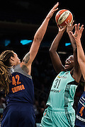 Tina Charles #31 of the New York Liberty has her shot blocked by Brittney Griner #42 of the Phoenix Mercury during the second round of the WNBA Playoffs at Madison Square Garden in New York on September 24, 2016. (Cooper Neill for The New York Times)