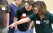 O.U.'s Gerri Botte directs teams in a battery-powered car competition during the Russ College of Engineering and Technology research fair/engineering day in the Baker Center ballroom on Thursday, 5/3/07.