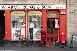 W Armstrong & Son vintage and second hand clothing shop at Grassmarket in Edinburgh Old Town, Scotland, UK