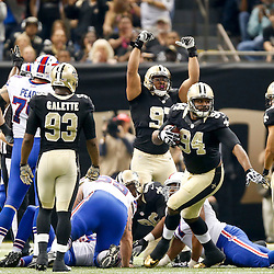 Oct 27, 2013; New Orleans, LA, USA; New Orleans Saints defensive end Cameron Jordan (94) recovers a fumble against the Buffalo Bills during the first quarter of a game at Mercedes-Benz Superdome. Mandatory Credit: Derick E. Hingle-USA TODAY Sports