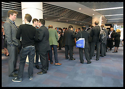 Delegates queue for David Cameron's speech  at the Conservative Party Conference  in Birmingham, Wednesday 10th October 2012. Photo by: Stephen Lock / i-Images