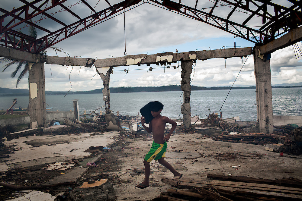 A boy plays in a destroyed building near City Hall in Tacloban City.