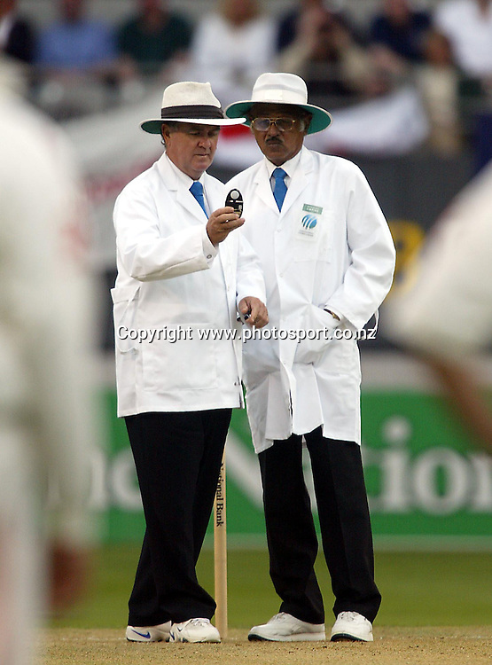 Umpires Doug Cowie and Srinivas Venkataraghavan check the ligh during the 3rd cricket test between England and New Zealand, 30 March, 2002, Eden Park, Auckland, New Zealand. Photo: Andrew Cornaga/PHOTOSPORT<br />