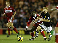 The FA Barclays Premiership<br />1 January 2005, The Riverside, Stadium, Middlesbrough<br />Middlesbrough v Manchester United<br />Manchester United's Paul Scholes outpaces Middlesbrough's Jimmy Floyd Hasselbaink during the Old Trafford side's 2-0 win at the Riverside Stadium<br />Pic Jason Cairnduff/Back Page Images