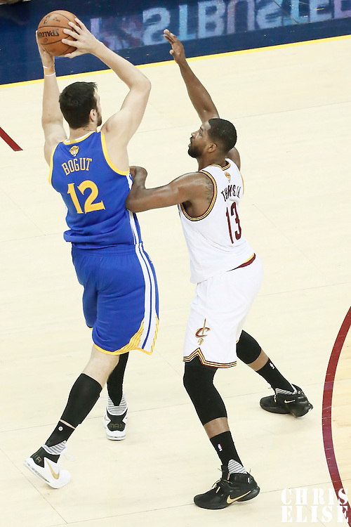 10 June 2016: Cleveland Cavaliers center Tristan Thompson (13) defends on Golden State Warriors center Andrew Bogut (12) during the Golden State Warriors 108-97 victory over the Cleveland Cavaliers, during Game Four of the 2016 NBA Finals at the Quicken Loans Arena, Cleveland, Ohio, USA.
