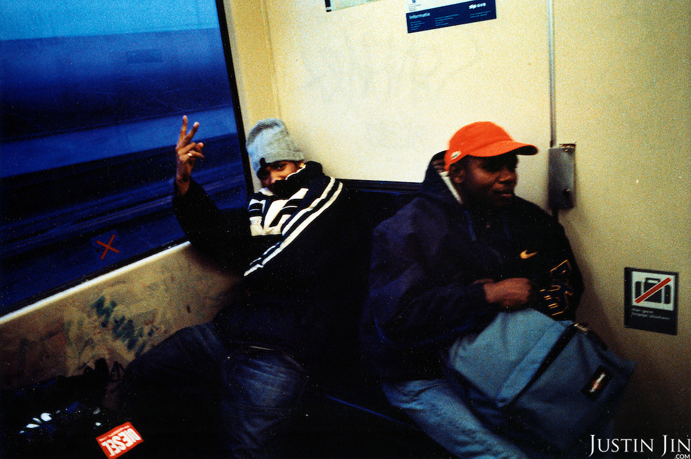 A youth traveling with his friend makes a hand gesture on the Gein metro line from the inner city area of Bijlmer to central Amsterdam. .Picture taken 2005 by Justin Jin