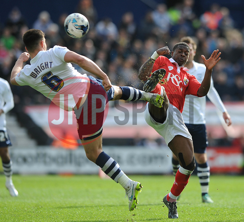 Bristol City's Kieran Agard challenges for the ball with Preston North End's Bailey Wright - Photo mandatory by-line: Dougie Allward/JMP - Mobile: 07966 386802 - 11/04/2015 - SPORT - Football - Preston - Deepdale - Preston North End v Bristol City - Sky Bet League One