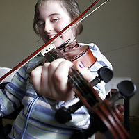Aoife Flannagan learning how to play the fiddle during workshops held in Gort community centre as part of the Cooley-Collins traditional music festival at the weekend.<br />
