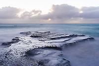 Waves breaking over sandstone platforms, Arniston, Western Cape, South Africa