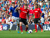 Football - 2013 / 2014 Premier League - Cardiff City vs. Everton<br /> ross barkley tackled by aron gunnarsson<br /> pic-winston bynorth/colorsport
