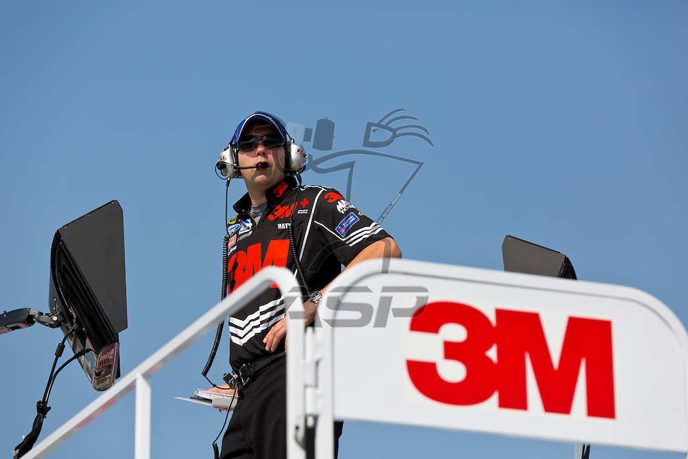 CONCORD, NC - MAY 26, 2012:  3M Crew Chief, Matt Puccia, watches a practice session for the Coca-Cola 600 at the Charlotte Motor Speedway in Concord, NC.