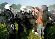 Bad Doberan   June 7, 2007. .Protest gegen den G8-Gipfel Heiligendamm, Tag 6: Aktivisten versuchen, eine Strassenblockade an der Zufahrtstra§e nach Heiligendamm bei Nieder-Bollhagen zu halten, Polizeikr?fte und Wasserwerder stehen zur R?umung bereit. Hier: Polizisten dr?ngen Demonstranten von der Stra§e zur?ck...Protests against the G8-Summit Heiligendamm, Day 6: Activists try to hold a read blockade on the road leading to Heiligendamm at Nieder-BollhagenHeiligendamm. Here: Demonstrators are being pushed back by riot policemen...20070607g8..[Inhaltsveraendernde Manipulation des Fotos nur nach ausdruecklicher Genehmigung des Fotografen. Vereinbarungen ueber Abtretung von Persoenlichkeitsrechten/Model Release der abgebildeten Person/Personen liegen nicht vor.]