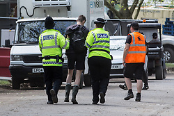 © Licensed to London News Pictures . 07/06/2015 . Manchester , UK . A festival goer is detained by police at The Parklife 2015 music festival in Heaton Park , Manchester . Photo credit : Joel Goodman/LNP