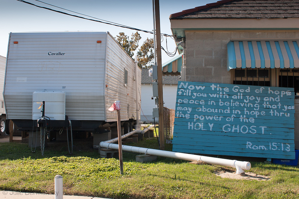 Religous sign next to a FEMA trailer in New Orleans post-Katrina