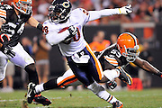 Sept. 2, 2010; Cleveland, OH, USA; Chicago Bears cornerback D.J. Moore (30) dodges a tackle by Cleveland Browns running back Thomas Brown (59) during the third quarter at Cleveland Browns Stadium. The Cleveland Browns beat the Chicago Bears 13-10. Mandatory Credit: Jason Miller-US PRESSWIRE